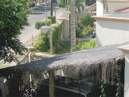 Ground-floor furnished three-bedroom house with enclosed, palapa-covered garage